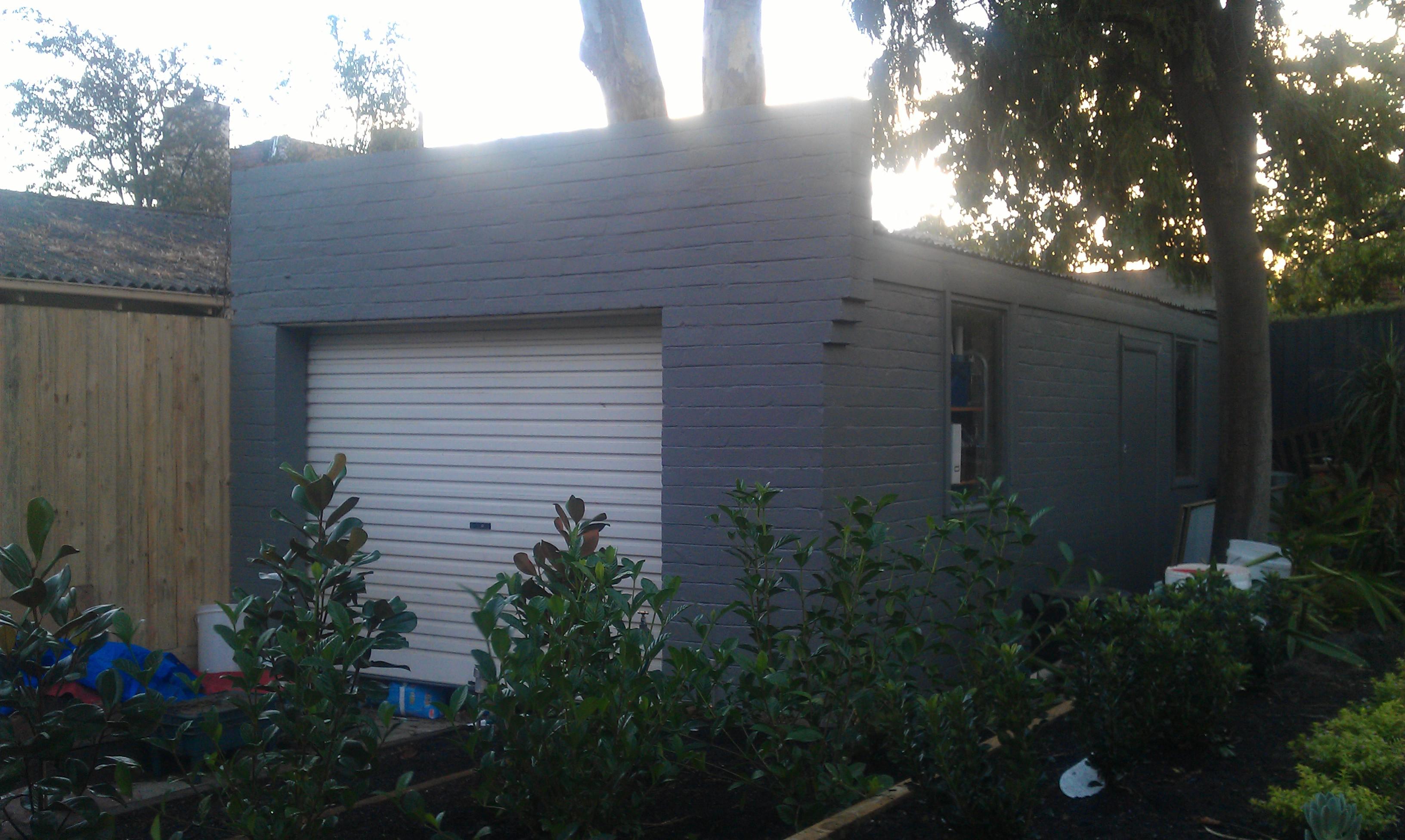 How to manually open a roller garage door